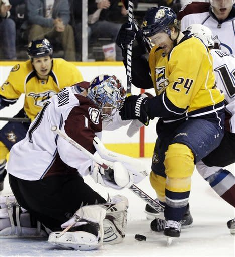 Colorado Avalanche goalie Semyon Varlamov (1), of Russia, blocks a shot as Nashville Predators right wing Matt Halischuk (24) tries for the rebound in the second period of an NHL hockey game on Thursday, March 8, 2012, in Nashville, Tenn. (AP Photo/Mark Humphrey)