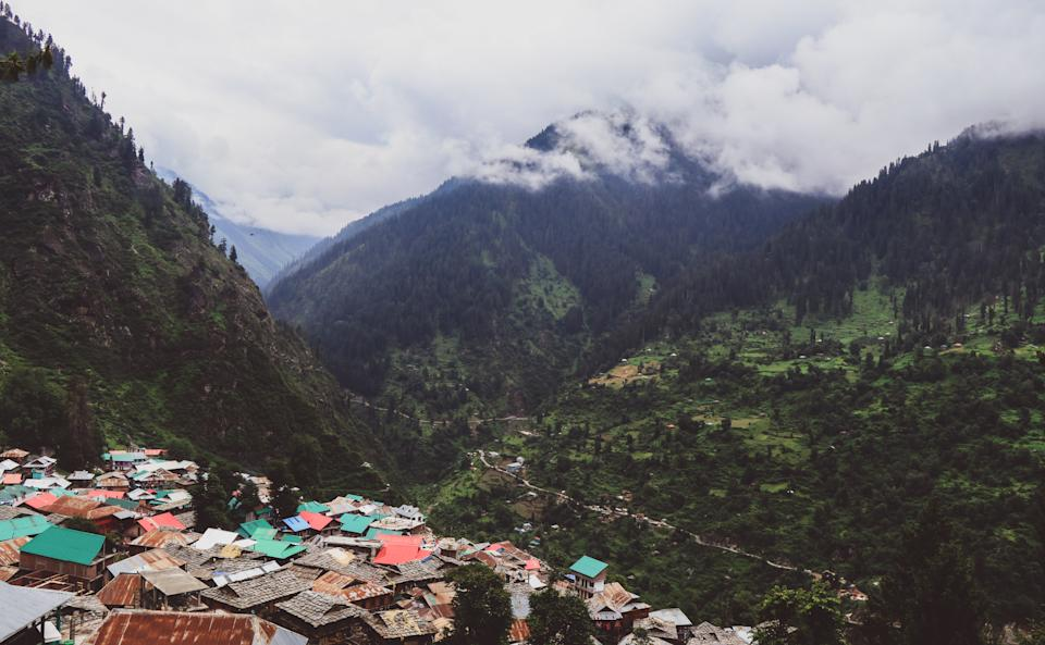 Ariel view of and from the mountain village of Malana, India. The place lushes with greenery in the summers, but as it is at 10000 ft, conical rooftops are made to stand the snowfalls of the winter. Its famous for its Quality Hashish, 5K