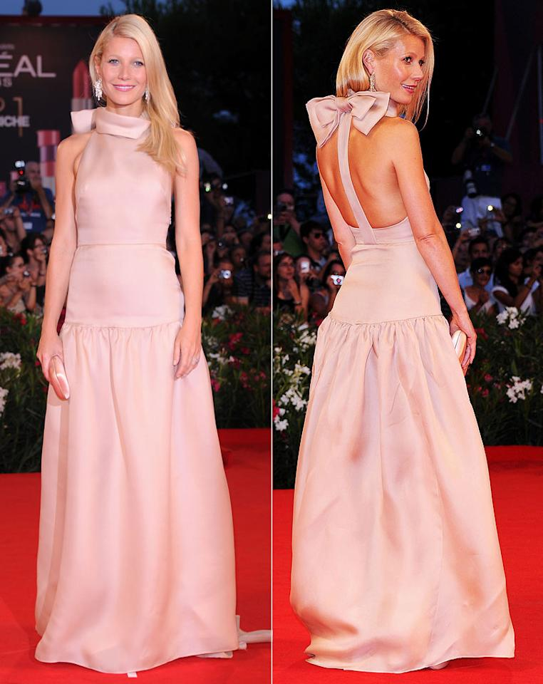 "Fellow Best Actress winner, Gwyneth Paltrow, was the epitome of elegance at the Venice International Film Festival premiere of her new thriller, ""Contagion."" The mom-of-two -- who turns 39 in three weeks -- turned heads in a blush pink Prada gown, which featured an organza bow on the back. A matching Prada clutch, Bvlgari earrings, and a side-swept 'do completed her flawless ensemble. Venturelli/<a href=""http://www.wireimage.com"" target=""new"">WireImage.com</a> - September 3, 2011"