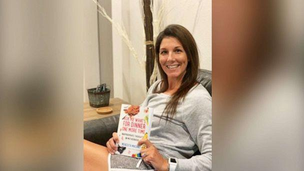 PHOTO: Meredith Masony, the founder of the popular parenting blog, poses with her new book, 'Ask Me What's For Dinner One More Time: Inappropriate Thoughts on Motherhood.' in an undated photo. (Courtesy of Meredith Masony)