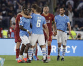 Roma and Lazio players hug at the end of a Serie A soccer match between Lazio and Roma, at the Rome Olympic stadium, Sunday, Sept. 1, 2019. Match ended 1-1. (AP Photo/Alessandra Tarantino)