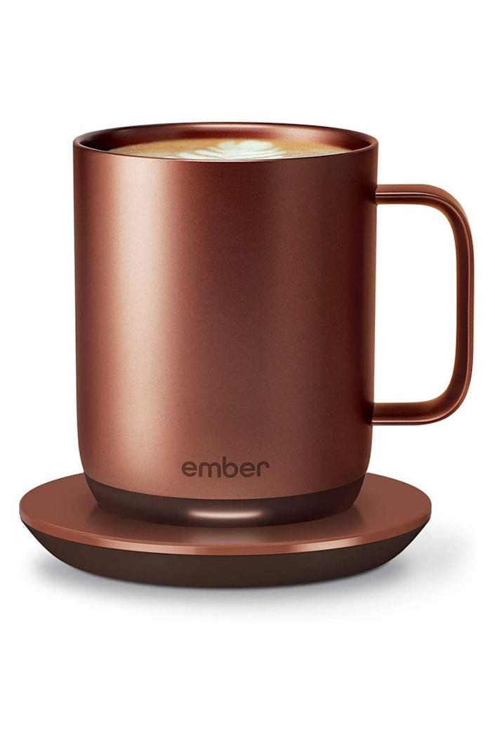 """<p><strong>Ember</strong></p><p>amazon.com</p><p><strong>$129.95</strong></p><p><a href=""""https://www.amazon.com/dp/B07Z5HHD52?tag=syn-yahoo-20&ascsubtag=%5Bartid%7C10072.g.26787035%5Bsrc%7Cyahoo-us"""" rel=""""nofollow noopener"""" target=""""_blank"""" data-ylk=""""slk:Shop Now"""" class=""""link rapid-noclick-resp"""">Shop Now</a></p><p>Her daily coffee is more important than ever—but, between feedings and diaper changes, there's no chance she'll get through the cup in one sitting. Enter this practical gift, which keeps her coffee or tea at the perfect temperature—anywhere between 120 and 145 degrees, set through a connected app—for as long as she wants. </p>"""