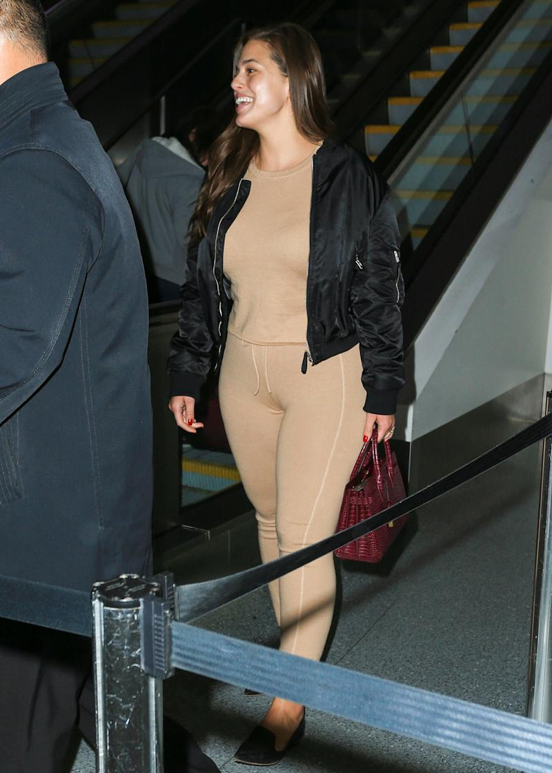 Ashley Graham Wears Nude Leggings at LAX Airport