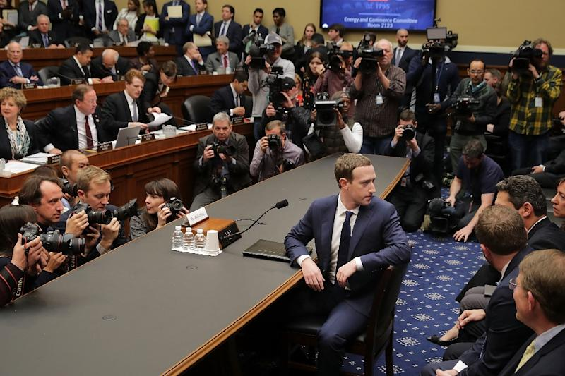 Lawmakers grilled Facebook co-founder and CEO Mark Zuckerberg in April, and now are considering legislation that could regulate how large tech firms collect and share personal data (AFP Photo/CHIP SOMODEVILLA)