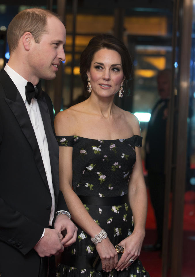 FILE - In this Sunday, Feb. 12, 2017 file photo, Britain's Prince William and Kate, Duchess of Cambridge meet BAFTA representatives as they arrive to attend the BAFTA British Academy Film Awards at the Royal Albert Hall in London. The red carpet will be a sea of black as the movement against sexual misconduct takes center stage at the British Academy Film Awards on Sunday Feb. 18. 2018. The Duchess of Cambridge is due to attend the Royal Albert Hall ceremony with husband Prince William, who is president of the British movie academy. (Daniel Leal-Olivas/Pool via AP, File)