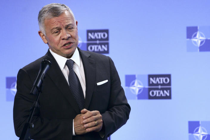 FILE - Jordan's King Abdullah II speaks during a media conference prior to a meeting with NATO Secretary General Jens Stoltenberg at NATO headquarters in Brussels, in this Wednesday, May 5, 2021, file photo. Hundreds of world leaders, powerful politicians, billionaires, celebrities, religious leaders and drug dealers have been stashing away their investments in mansions, exclusive beachfront property, yachts and other assets for the past quarter century, according to a review of nearly 12 million files obtained from 14 different firms located around the world. The report released Sunday, Oct. 3, 2021, by the International Consortium of Investigative Journalists involved 600 journalists from 150 media outlets in 117 countries. Jordan's King Abdullah II is one of 330 current and former politicians identified as beneficiaries of the secret accounts. (Johanna Geron, Pool via AP, File)