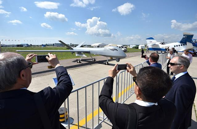 <p>Visitors take pictures of the new Chinese made drone Wing Loong on July 18, 2017 at the annual air show MAKS 2017 in Zhukovsky, some 40 km outside Moscow, Russia. (Photo: Mladen Antonov/AFP/Getty Images) </p>
