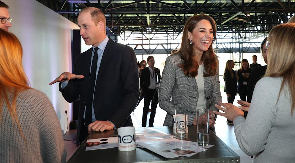 Britain's Prince William, Duke of Cambridge (3L) and his wife Britain's Catherine, Duchess of Cambridge (2R) attend the charity Shout's Crisis Volunteer celebration event at the Troubadour White City Theatre in London on November 12, 2019. - Shout is a 24/7 text support service which was researched and developed by The Royal Foundation as a legacy of the Heads Together Campaign. The annual volunteer day celebrates the hundreds of trained Crisis Volunteers who operate the 24/7 service. Shout aims to encourage people to reach out for support at an early stage, without fear or shame. (Photo by Yui Mok / POOL / AFP) (Photo by YUI MOK/POOL/AFP via Getty Images)