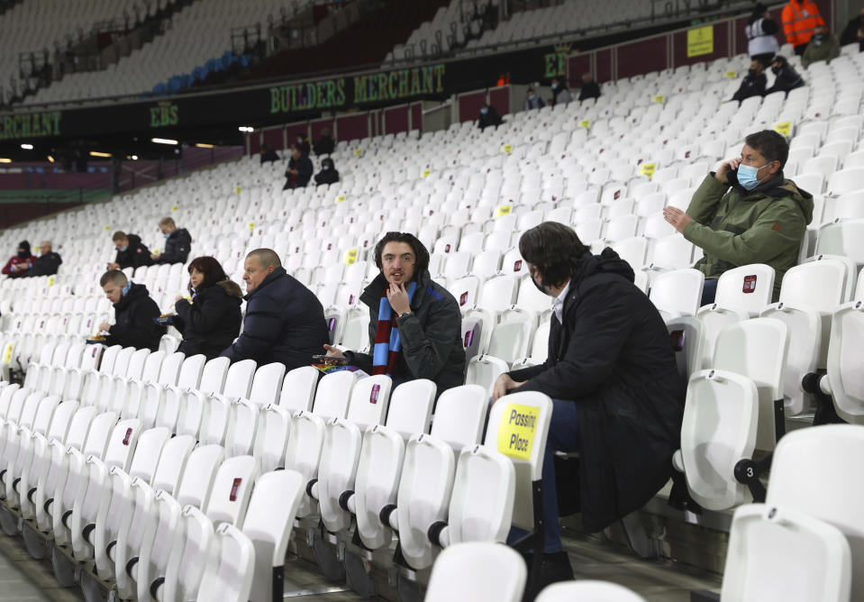 West Ham United fans inside the stadium before the English Premier League soccer match between West Ham United and Manchester United at the London stadium in London, England, Saturday, Dec. 5, 2020. (Julian Finney/Pool Via AP)