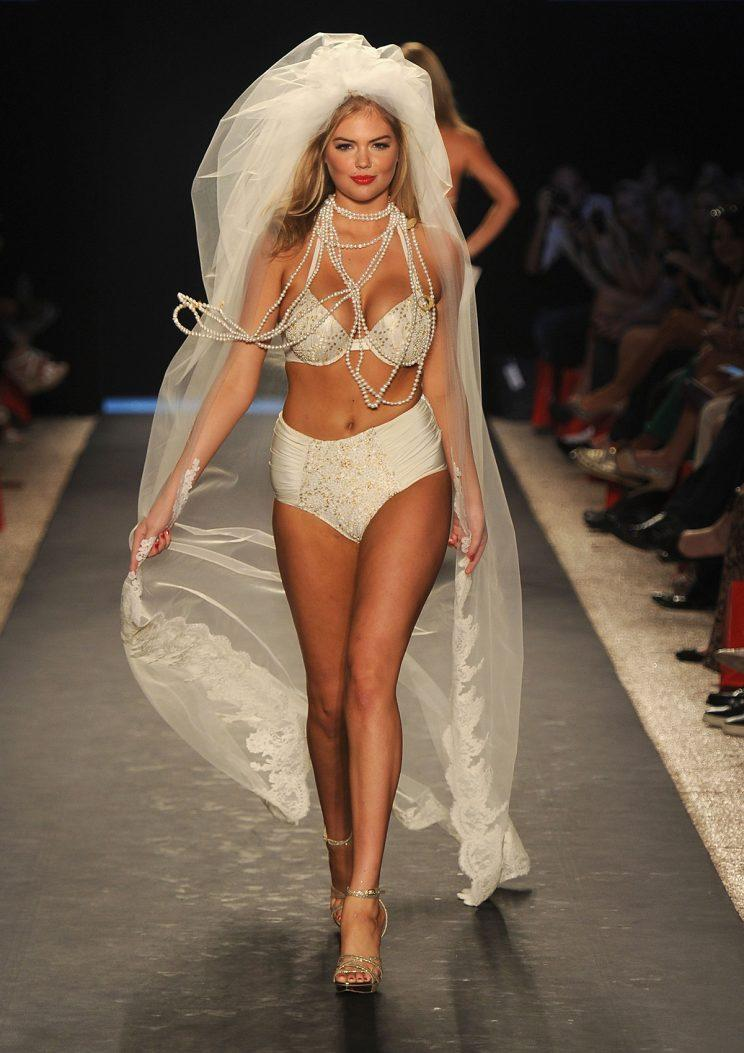 Kate Upton wearing a high-waisted bridal bikini.(Photo: Getty Images)