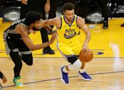 Golden State's Stephen Curry is guarded by Sacramento's Marvin Bagley in the Warriors' 137-106 NBA win over the Kings