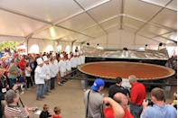 "<p>A group of giant pumpkin growers in New Bremen, Ohio, banded together at their local pumpkinfest to bake a Thanksgiving dessert of epic proportions. The largest <a href=""https://www.goodhousekeeping.com/food-recipes/g3986/pumpkin-pie-recipes/"" rel=""nofollow noopener"" target=""_blank"" data-ylk=""slk:pumpkin pie"" class=""link rapid-noclick-resp"">pumpkin pie</a> even won a Guinness World Record for weighing in at 3,699 pounds. It was made up of 440 sheets of pie dough, plus huge quantities of canned pumpkin, evaporated milk, eggs, sugar and seasonings. </p>"