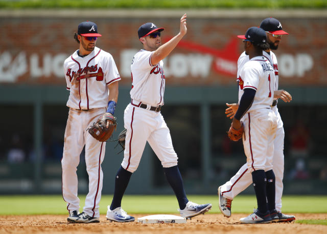 Atlanta Braves first baseman Freddie Freeman celebrates with teammates after the Braves beat the New York Mets 2-0 in a baseball game Wednesday, June 13, 2018, in Atlanta. (AP Photo/Todd Kirkland)