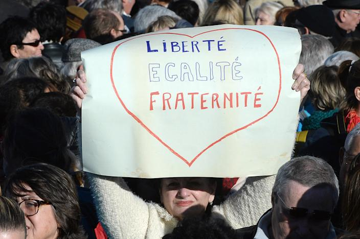 """A woman holds a sign reading """"Freedom, equality, brotherhood"""" during a demonstration attended by an estimated 45.000 in Marseille, southeastern France, on January 10, 2015 (AFP Photo/Boris Horvat )"""