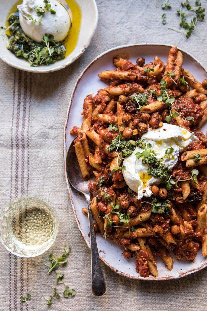 """<strong><a href=""""https://www.halfbakedharvest.com/easiest-tomato-basil-penne-with-spicy-italian-chickpeas/"""" target=""""_blank"""" rel=""""noopener noreferrer"""">Get theEasiest Tomato Basil Penne with Spicy Italian Chickpeas recipe from Half Baked Harvest</a></strong>"""