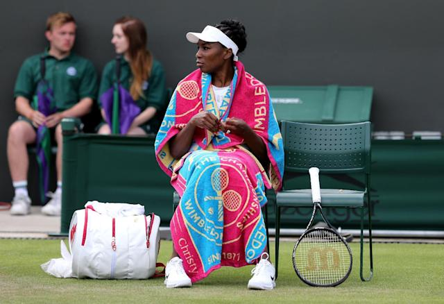 American Venus Williams rests between sets during her women's singles second round match against Japan's Kurumi Nara on day three of the 2014 Wimbledon Championships at The All England Tennis Club in Wimbledon, southwest London, on June 25, 2014 (AFP Photo/Andrew Cowie)
