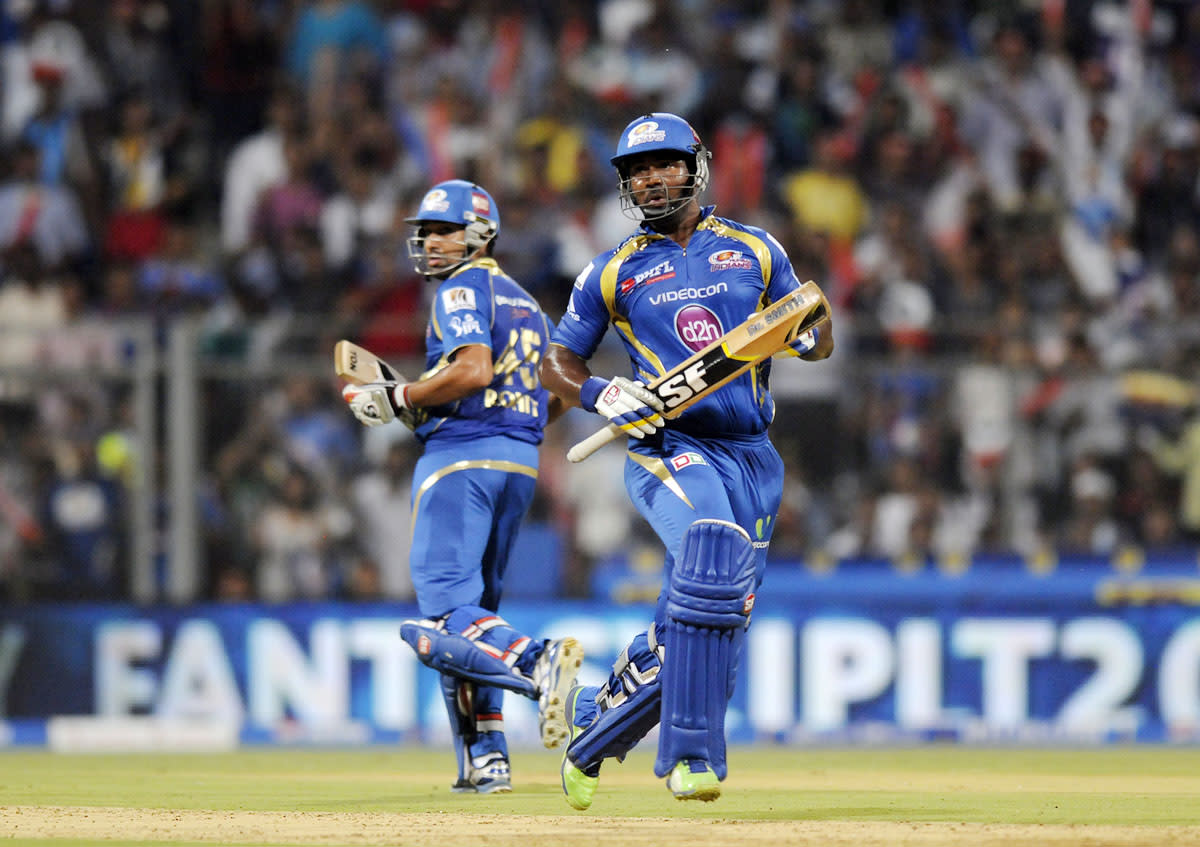 Dwayne smith of Mumbai Indians and Rohit sharma captain of Mumbai Indians run between the wickets during match 41 of the Pepsi Indian Premier League ( IPL) 2013  between The Mumbai Indians and the Kings XI Punjab held at the Wankhede Stadium in Mumbai on the 29th April 2013. (BCCI)