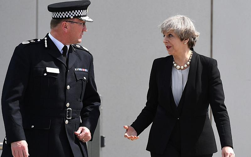 Theresa May talks with Chief Constable of Greater Manchester Police Ian Hopkins - Credit: Leon Neal/Getty Images