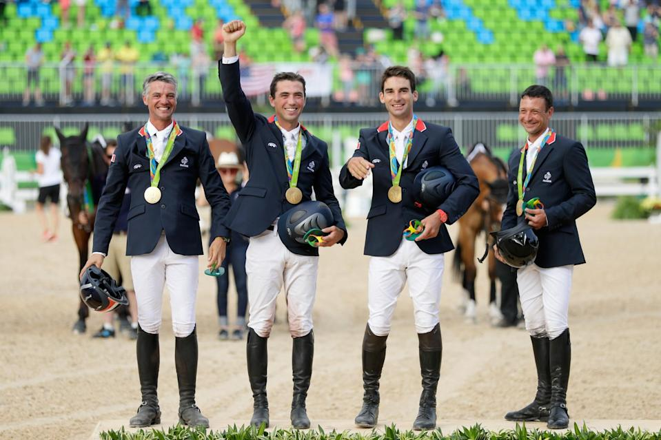 <p>Gold medal medalist's Karim Laghouag, Thibaut Vallette, Mathieu Lemoine and Astier Nicolas of France pose during the medal ceremony for the eventing team jumping final on Day 4 of the Rio 2016 Olympic Games at the Olympic Equestrian Centre on August 9, 2016 in Rio de Janeiro, Brazil. (Photo by Jamie Squire/Getty Images) </p>