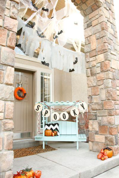 """<p>This pretty porch makes use of its high archway with a web of bats that will delight any trick-or-treater. </p><p><strong>Get the tutorial at <a href=""""http://thecraftingchicks.com/festive-halloween-porch-tricks/#_a5y_p=2081354"""" rel=""""nofollow noopener"""" target=""""_blank"""" data-ylk=""""slk:The Crafting Chicks"""" class=""""link rapid-noclick-resp"""">The Crafting Chicks</a>.</strong> </p>"""