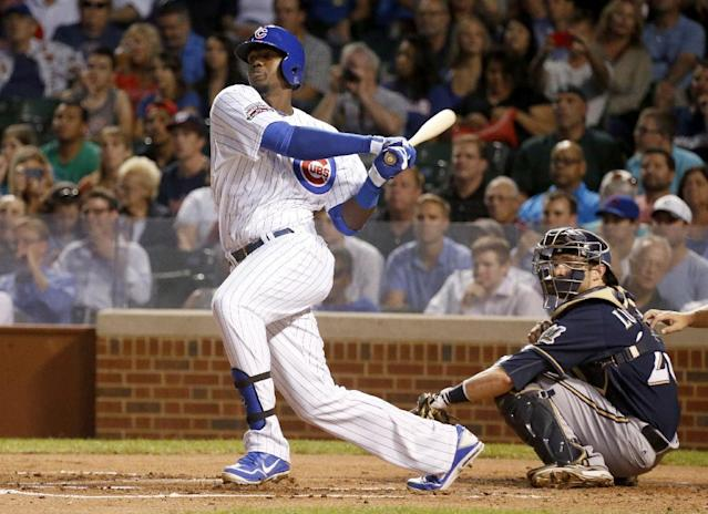 Chicago Cubs' Jorge Soler hits an RBI single off Milwaukee Brewers starting pitcher Yovani Gallardo, scoring Starlin Castro, during the first inning of a baseball game Tuesday, Sept. 2, 2014, in Chicago. (AP Photo/Charles Rex Arbogast)