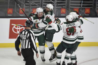 Minnesota Wild defenseman Mathew Dumba (24) congratulates defenseman Ryan Suter, left, on a game-tying goal during the third period of the team's NHL hockey game against the Los Angeles Kings in Los Angeles, Saturday, Jan. 16, 2021. (AP Photo/Kelvin Kuo)