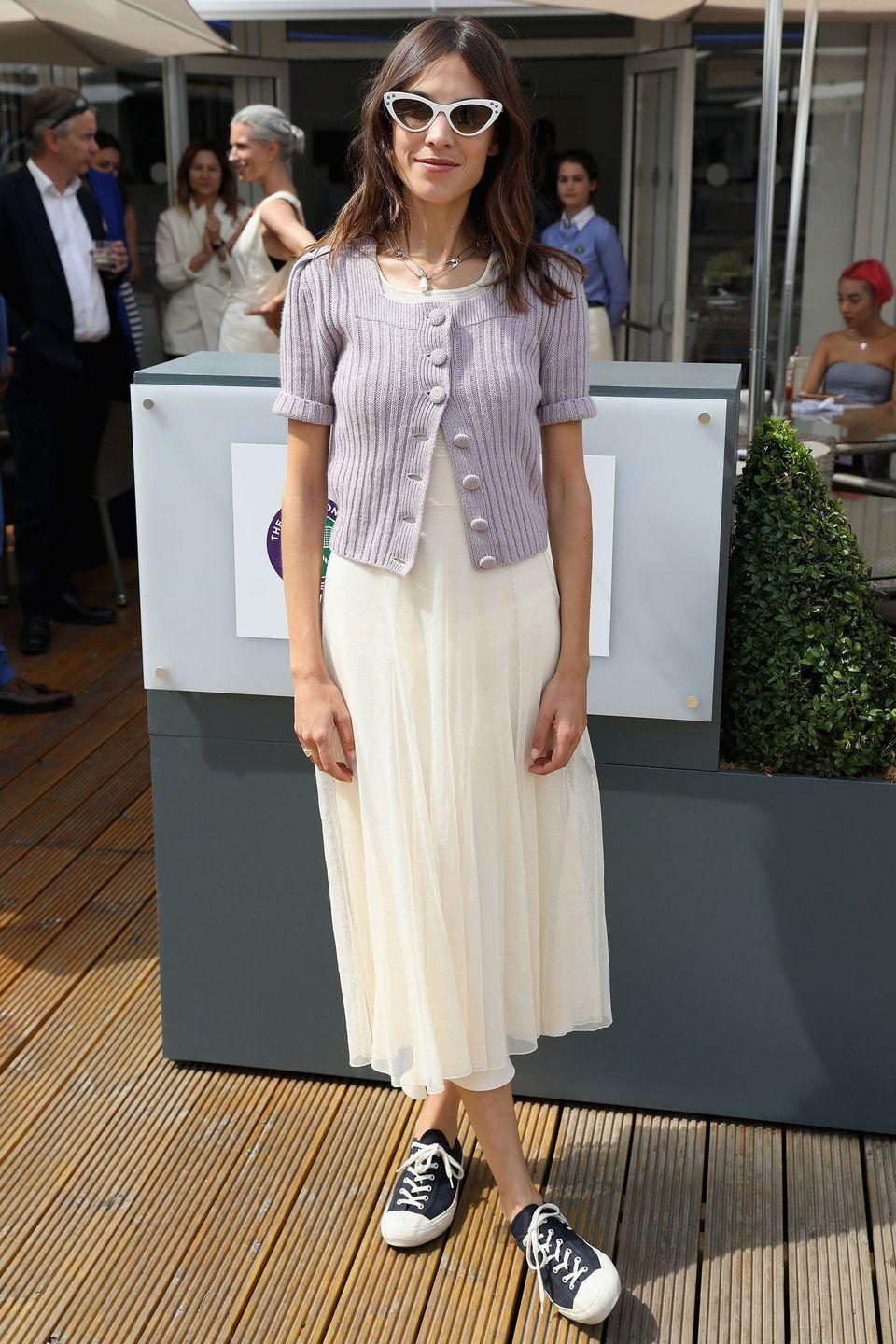 <p><strong>2018 </strong>Alexa Chung kept it casual in a simple white dress, trainers and a lilac cardigan.</p>