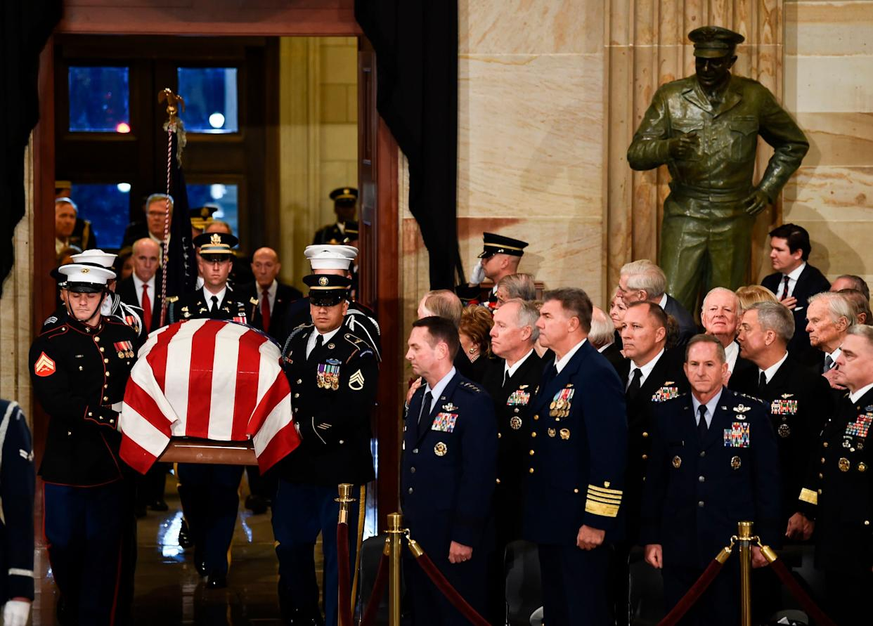 The casket bearinghis remains is carried into the Capitol Rotunda.