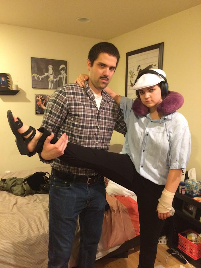"""A couple dressed as Air Marshall John and Megan from """"Bridesmaids"""" pose for a photo."""