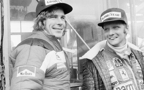 Niki Lauda, right, and James Hunt, of Britain, look at the rain before the start of the Japan Grand Prix Formula One, 1976 - Credit: AP/Nuck Ut