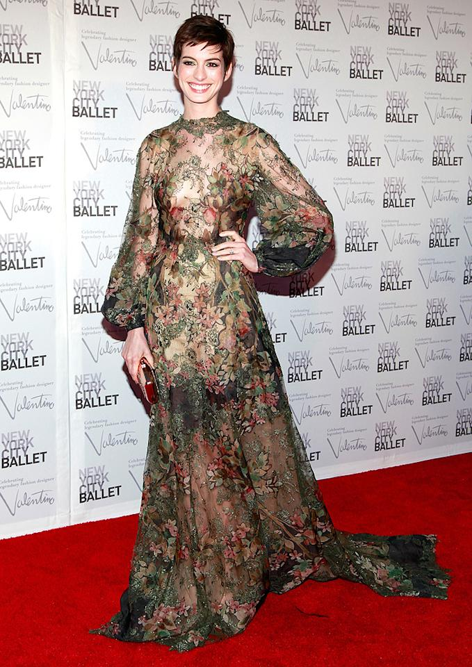 """We love Anne Hathaway and we love Valentino, but we're never all that impressed when the actress and designer join forces on the red carpet. On Thursday night, Anne attended the NYC Ballet's fall gala in this embroidered gown. It may be interesting and intricate and wildly expensive, but that doesn't change the fact that it makes her look like the Creature from the Black Lagoon. (9/20/2012)<br><br><a target=""""_blank"""" href=""""http://bit.ly/lifeontheMlist"""">Follow What Were They Thinking?! creator, Matt Whitfield, on Twitter!</a>"""