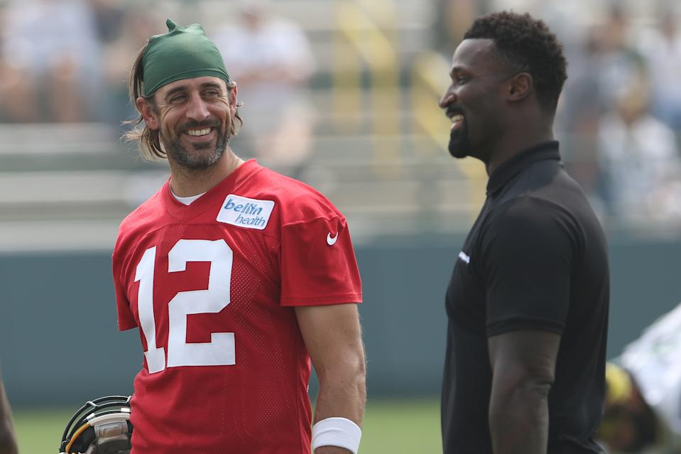 Green Bay Packers quarterback Aaron Rodgers (12) talks with NFL Network host and former Packers teammate James Jones during a training camp practice. (Photo by Larry Radloff/Icon Sportswire via Getty Images)