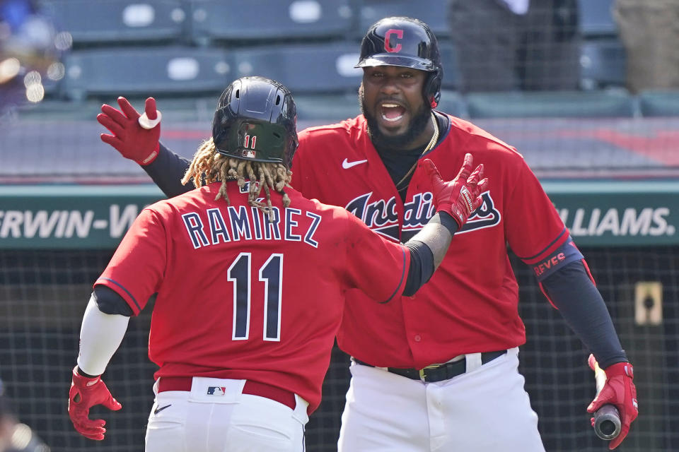 Cleveland Indians' Franmil Reyes, right, congratulates Cleveland Indians' Jose Ramirez after Ramirez hit a two-run home run in the eighth inning of a baseball game against the Kansas City Royals, Wednesday, April 7, 2021, in Cleveland. The Indians won 4-2. (AP Photo/Tony Dejak)