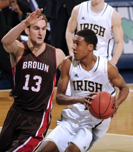 Notre Dame guard Cameron Beidscheid, right, drives the lane as Brown guard Tyler Ponticelli, defends during second half of an NCAA college basketball game with Brown on Saturday Dec. 8, 2012 in South Bend, Ind. Beidscheid lead with 17 points as Notre Dame won 84-57. (AP Photo/Joe Raymond)