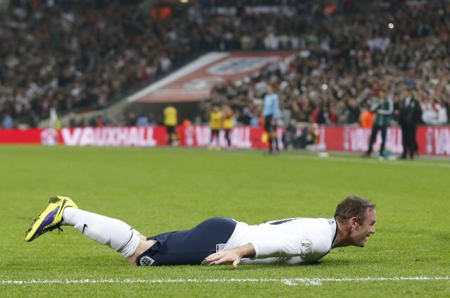 England's Wayne Rooney celebrates after scoring the opening goal during the World Cup Group H qualification soccer match between England and Poland at Wembley stadium in London, Tuesday, Oct. 15, 2013. (AP Photo/Matt Dunham)