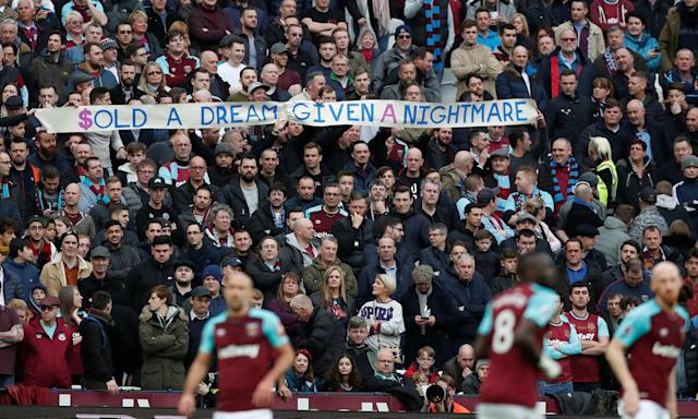 West Ham fans protest against the board during Saturday's defeat by Burnley.
