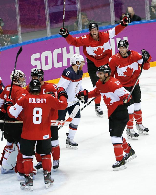 Canada celebrates their 1-0 victory over Team USA in the men's semifinal ice hockey game at the 2014 Winter Olympics, Friday, Feb. 21, 2014, in Sochi, Russia. (AP Photo/Matt Slocum)