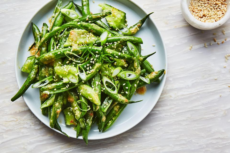 "Crushing and smashing green beans and cucumbers creates nooks and crannies to soak up as much umami-rich miso sauce as possible. And this is a dressing you'll want a lot of. <a href=""https://www.epicurious.com/recipes/food/views/green-beans-and-cucumbers-with-miso-dressing?mbid=synd_yahoo_rss"" rel=""nofollow noopener"" target=""_blank"" data-ylk=""slk:See recipe."" class=""link rapid-noclick-resp"">See recipe.</a>"
