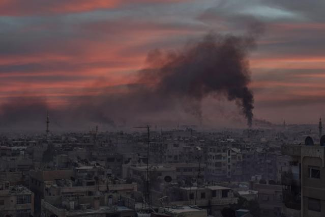 <p>Smoke rises after Assad Regime carried out an airstrike at Duma town of Eastern Ghouta in Damascus, Syria on April 7, 2018. (Photo: Mouneb Taim/Anadolu Agency/Getty Images) </p>