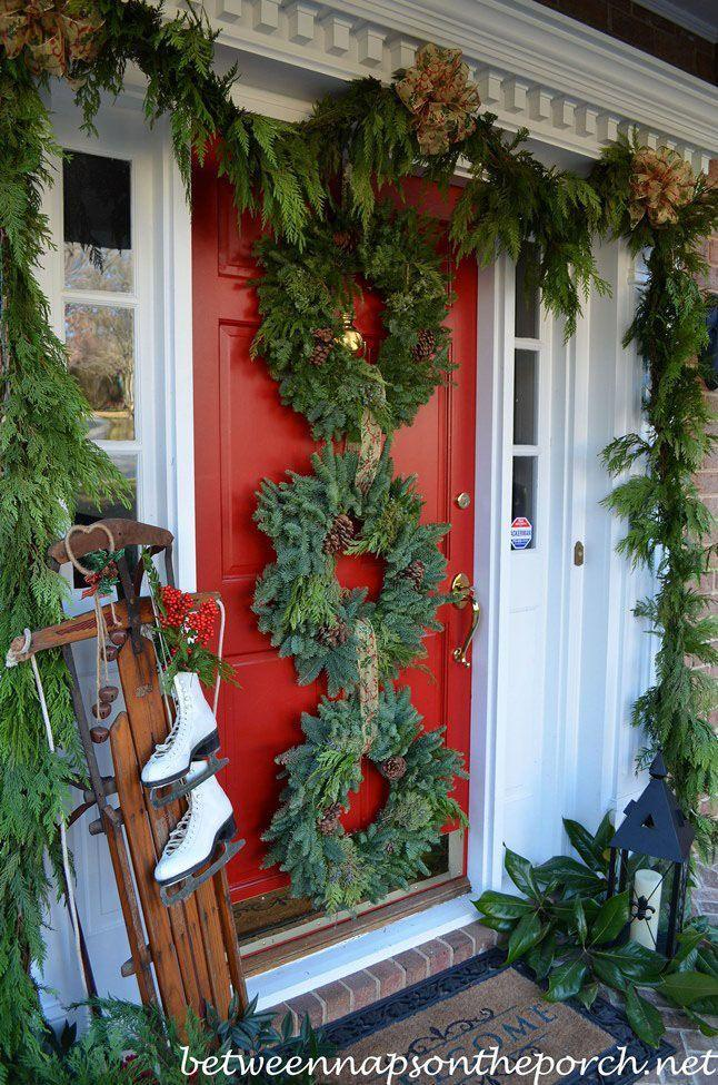 "<p>Make your entryway a vision in green by displaying a trio of wreaths between thick, flowing garland. <br></p><p><a class=""link rapid-noclick-resp"" href=""https://www.amazon.com/Northlight-V03944-Artificial-Christmas-Wreath/dp/B0761WY9QB?tag=syn-yahoo-20&ascsubtag=%5Bartid%7C10055.g.2361%5Bsrc%7Cyahoo-us"" rel=""nofollow noopener"" target=""_blank"" data-ylk=""slk:SHOP PINE WREATHS"">SHOP PINE WREATHS</a></p><p><em><a href=""http://betweennapsontheporch.net/front-porch-decorated-for-christmas/"" rel=""nofollow noopener"" target=""_blank"" data-ylk=""slk:See more at Between Naps on the Porch »"" class=""link rapid-noclick-resp"">See more at Between Naps on the Porch »</a></em></p>"