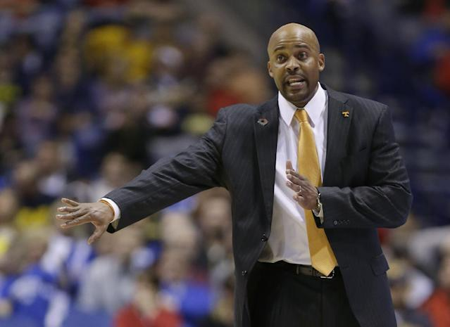 FILE - In this March 28, 2014, file photo, Tennessee head coach Cuonzo Martin directs his team during the second half of an NCAA Midwest Regional semifinal college basketball tournament game against Michigan in Indianapolis. Cal announced the hiring of Tennessee's Martin Tuesday, April 15, 2014. He replaces Mike Montgomery, who retired last month after six seasons in Berkeley. (AP Photo/Michael Conroy, File)