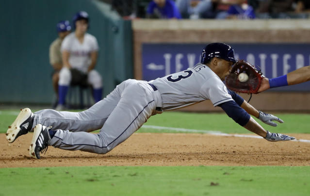Tampa Bay Rays pinch-runner Johnny Davis is picked off trying to get back to first by a throw from Texas Rangers relief pitcher Ian Gibaut to first baseman Ronald Guzman, right, during the seventh inning of a baseball game in Arlington, Texas, Wednesday, Sept. 11, 2019. Davis made his major league debut with the appearance. (AP Photo/Tony Gutierrez)