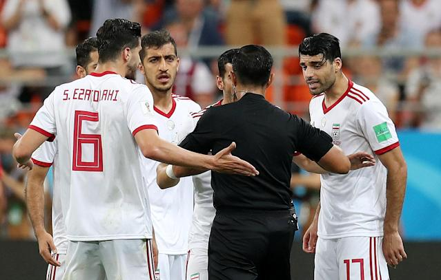 Soccer Football - World Cup - Group B - Iran vs Portugal - Mordovia Arena, Saransk, Russia - June 25, 2018 Iran's Mehdi Taremi and team mates remonstrate with referee Enrique Caceres REUTERS/Ricardo Moraes