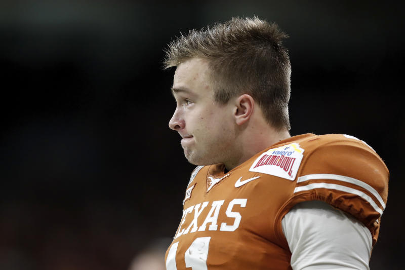 Sam Ehlinger has shown development as a passer each season for Texas, but he still has work to do to boost his draft stock. (Photo by Tim Warner/Getty Images)