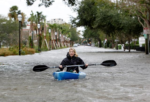 <p>A Charleston resident kayaks down a flooded Rutledge Avenue after Hurricane Matthew hit Charleston, S.C., Oct. 8, 2016. (Photo: Jonathan Drake/Reuters) </p>