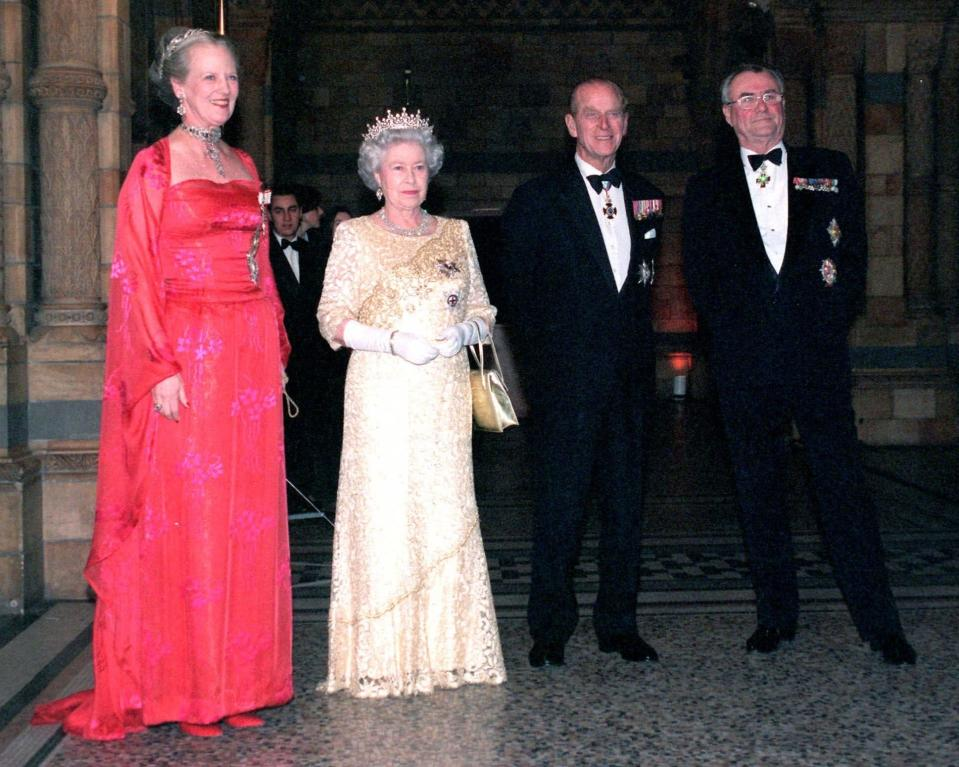FILE - In this Thursday Feb. 17, 2000, file photo, Queen Margrethe of Denmark, Britain's Queen Elizabeth II, Prince Philip and Prince Henrik, from left, welcome guests to a reception hosted by Margrethe at the Natural History Museum. Prince Philip's life spanned just under an entire century of European history. His genealogy was just as broad, with Britain's longest-serving consort linked by blood and marriage to most of the continent's royal houses. (AP Photo/Michael Stephens, File)