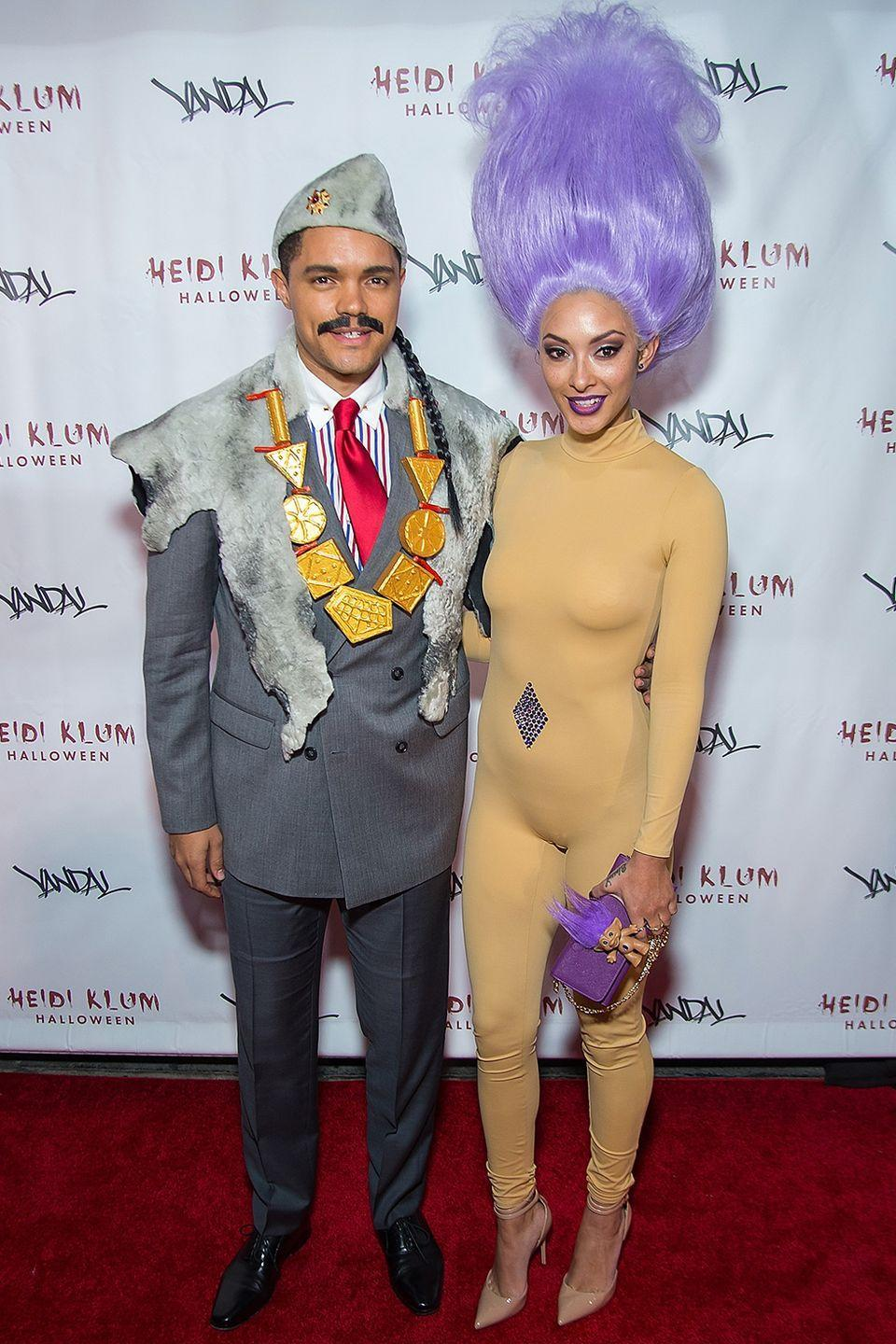 <p>While not exactly matching, <em>The Daily Show</em> host Trevor Noah looked great as Eddie Murphy's character from <em>Coming to America</em>, and girlfriend Jordyn Taylor wore an impressive Trolls costume to Heidi Klum's 2016 Halloween party.</p>