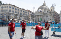 Turkish supporters play with a soccer ball in Rome's Piazza del Popolo hours before the start of the Euro 2020 soccer championship group A match between Italy and Turkey, at the Rome Olympic stadium Friday, June 11, 2021. Postponed by a year, the biggest sports event since the coronavirus brought the world to a halt kicks off Friday at Rome's Stadio Olimpico, a milestone both for Europe and global sports. (AP Photo/Riccardo De Luca)