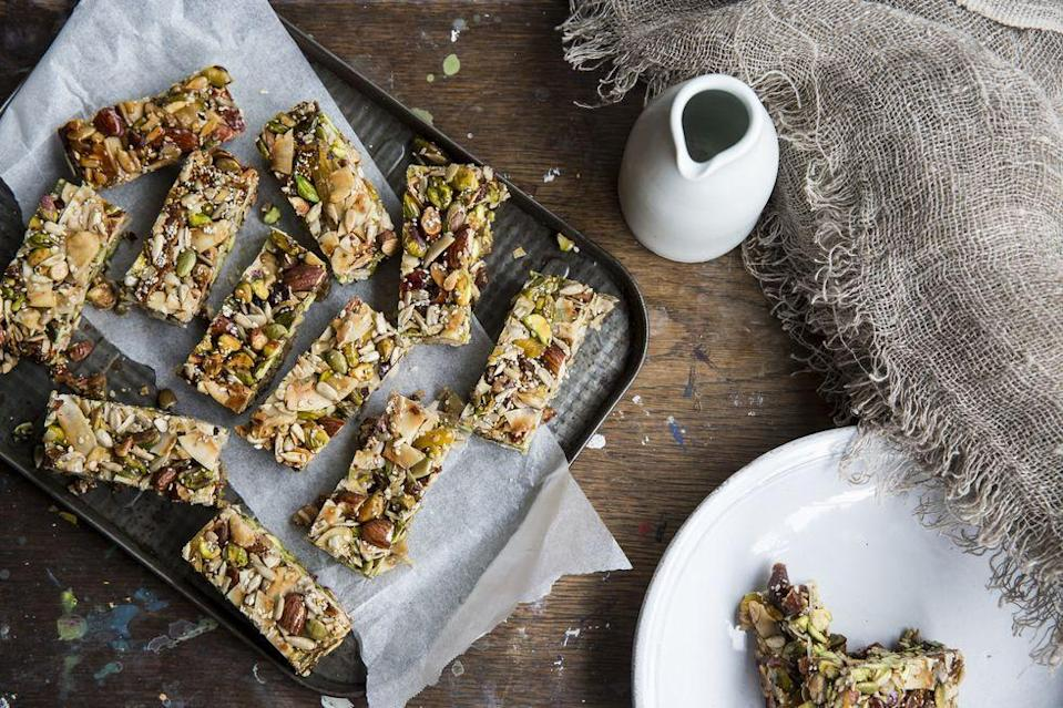 <p>You can prepare your own healthy snacks in bulk if you'd like, or simply buy them and keep them in your kitchen. It's never a bad idea to take them with you whenever you're going out too. </p><p>Some ideas for healthy snacks include protein bars that are low on sugar, carrots or celery sticks with hummus, Greek yogurt with apples or berries, a smoothie with lots of veggies or fruits (and no added sugar), or something like chia seed pudding that you can make on your own. </p>
