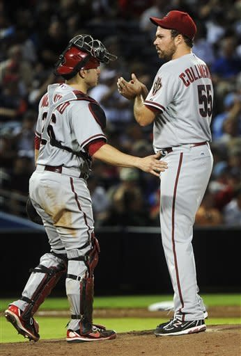 Arizona Diamondbacks pitcher Josh Collmenter is approached at the mound by catcher Miguel Montero before being removed from the baseball game against the Atlanta Braves, Tuesday, June 26, 2012, in Atlanta. (AP Photo/John Amis)